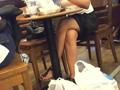 girls sexy crossed legs hot feets toes at cafe