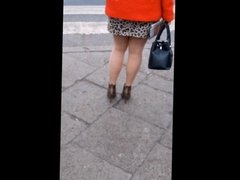 #102 Woman with sexy legs in mini skirt and high heels