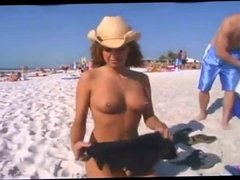 Girl gets naked in front of friends on a beach