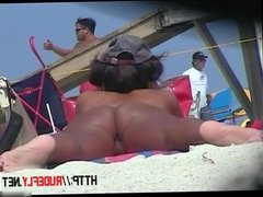 Naked hotties followed around by a nude beach voyeur
