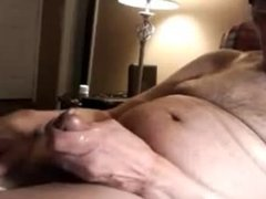 Old man (cut cock) wanking off on cam