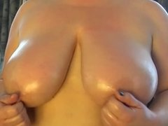 Lesbian BBW talks dirty and slaps her tits.