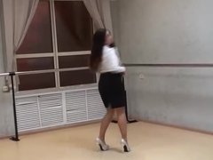 Sexy girl dancing in short skirt