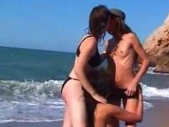 A Lesbian Threesome On The Beach