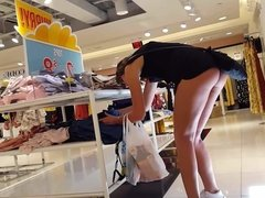 Candid voyeur teen showing ass cheeks while shopping