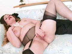 Brunette Sophia Delane big tits in lingerie opens nylon legs fingers pussy