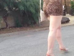 MILF in very short dress spying