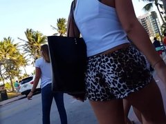 Candid voyeur girl in tiny leopard print shorts