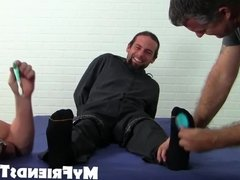 Bearded guy dude gets his feet and body tickled by two gays