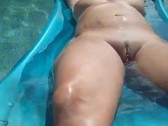 Sexy nude girl in the pool