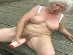 Granny Norma nude and alone at the jetty