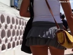 Summer windy day lifts short skirt