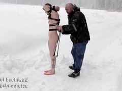 Naked and barefoot Vika tied up in the snow