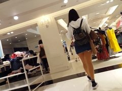Candid voyeur teen hottie trying on shoes in skirt