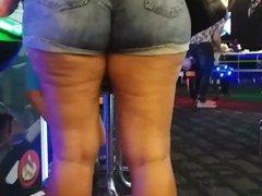 Candid Latina milf, wearing ass eating  shorts.