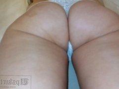 Upskirt girl with beautiful ass in white panties.