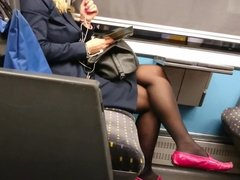 Spying Blonde MILF wearing sexy black pantyhose on a train