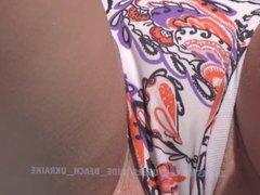 Ukrainian girl spreads her legs widely on the beach. Spy Cam