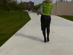 Nice lady in tight leather skirt walking outside