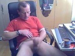 Horny dad wanks off his uncut cock