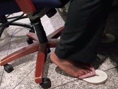 Co worker ebony feet in flip flops