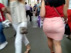 Round ass in pink skirt
