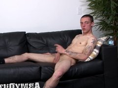 Young army man exercises with his hard boomstick solo