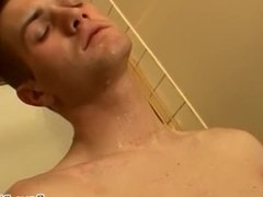 Twink pissing all over his body and wanking his massive dick