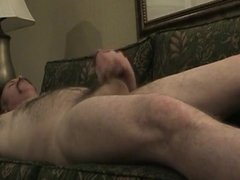 Hairy daddy stroking on the couch
