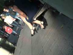 Candid young girl with hot legs and high heels sandals