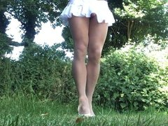Windy upskirt in tan pantyhose outdoors.
