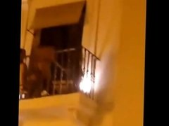 British girl showing her tits on a balcony in Pamplona