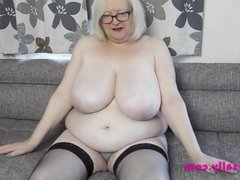 Blonde Granny in stockings and heels spreads and plays
