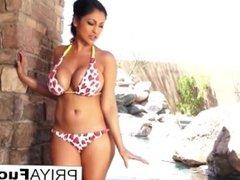 Busty Priya Rai gets all wet outside by the pool