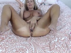 Blonde Cougar with amazing tits takes all 10 inches