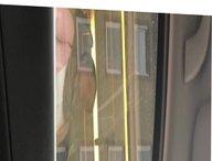 Girl watches dickflash through bus window
