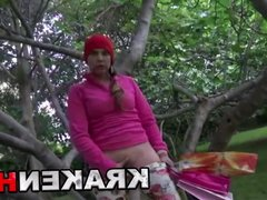Young brunette girl gets naked in the park