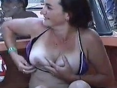 Slut exposes her tits in front of crowd