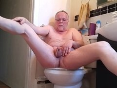 Pissing fun in the bathroom.
