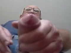 Watching dad wanking his uncut cock and cumming