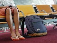 Boy put on flip flops and anklet in airport