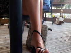 My feet in sandal under the table at the restaurant pw