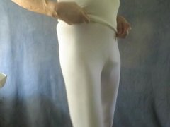 Sissy bitch in tight white spandex shakes his fem ass.