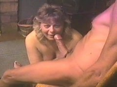 Giving him a blowjob and spit it on my tits