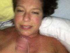 Milf sucking dick and swallowing cum while she gets off