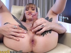 Inked blonde TS fingers her tight asshole and masturbates
