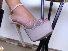 Barefoot teen in high heels gets a foot massage