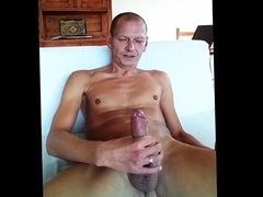 Shaven nudist Dirk shooting a big load