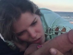 hot slut sucks big cock on the beach and takes cum in mouth