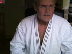 in a bathrobe and without